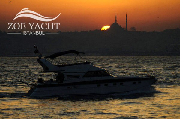 Image of a Bosphorus cruise boat at Istanbul sunset time in Turkey